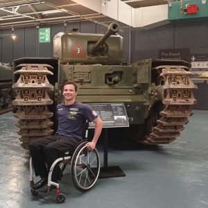 Aaron in front of tank