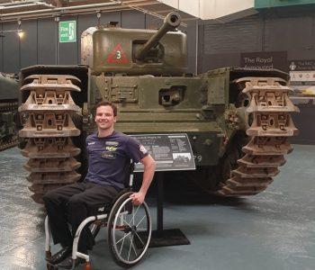 Aaron in front of tank