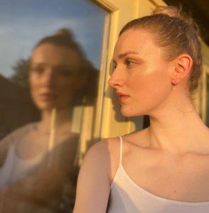 Woman side on looking into window