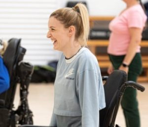 Blonde female in wheelchair smiling
