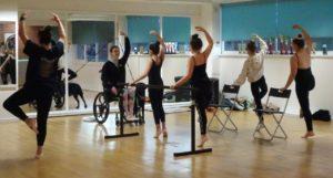 Female wheelchair user teaching ballet dance class